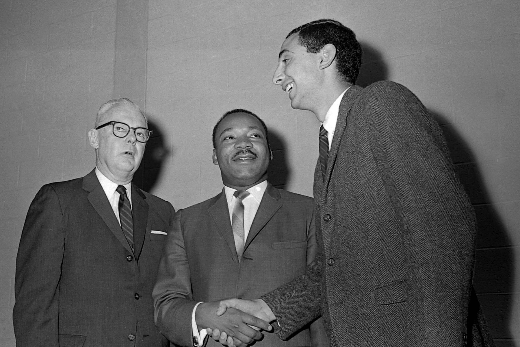 A photograph of William G. Van Note, president of Monmouth College from 1962–1971, Michael Dadd '68, president of Monmouth's student union council in 1966, and Martin Luther King Jr.