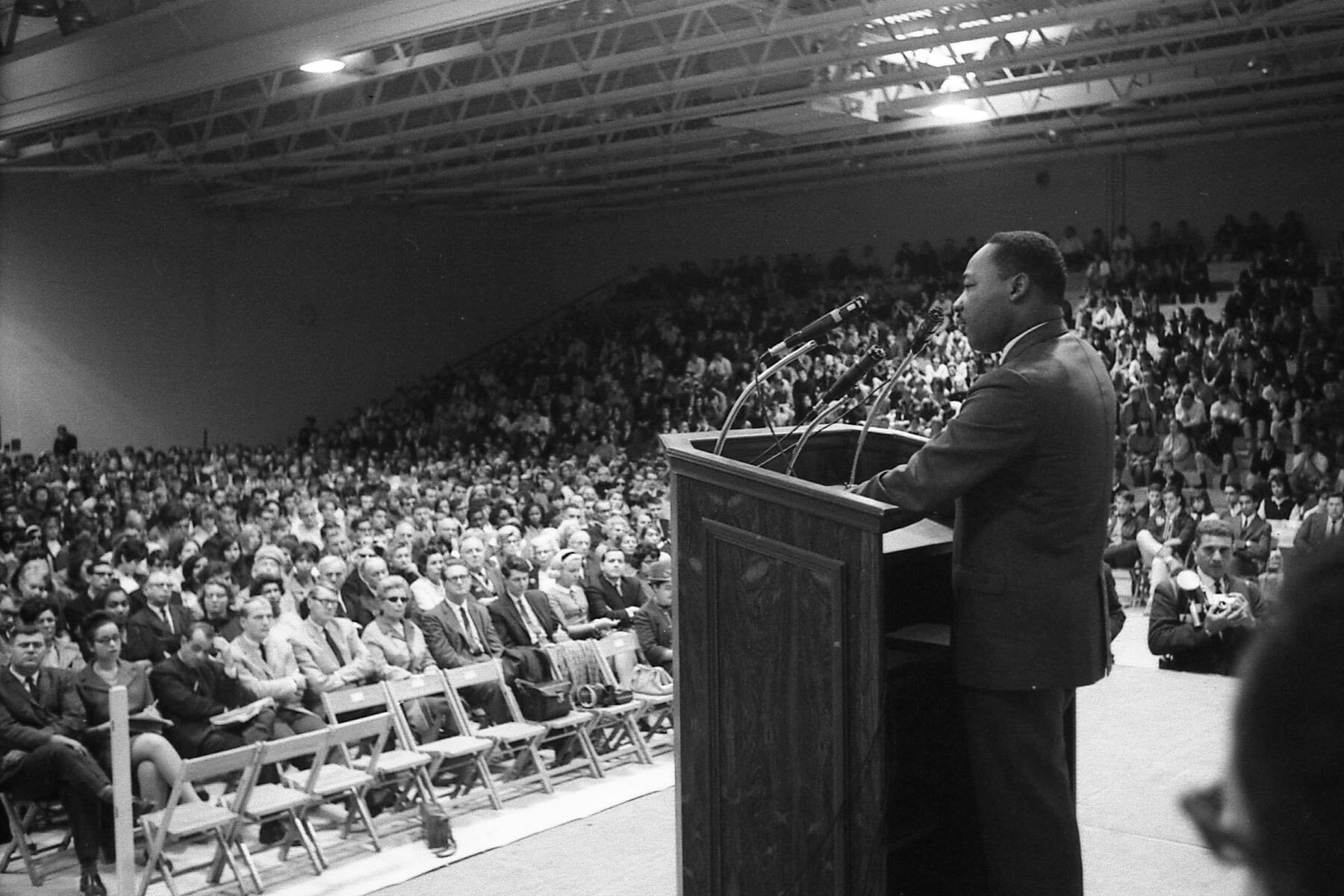 Martin Luther King Jr. speaking to a captive audience in Boylan Gymnasium