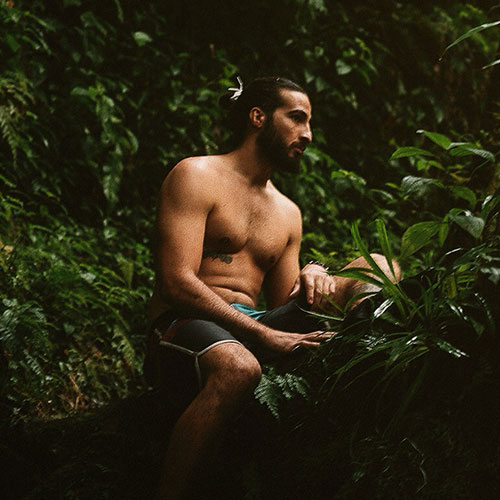Jorge Branco surrounded by shrubbery