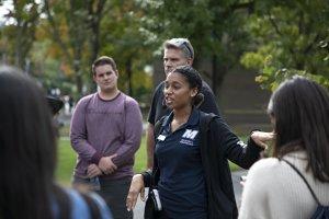 University ambassador guiding students on a tour.