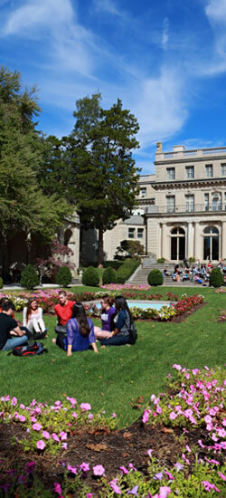 Students sitting on lawn outside Wilson Hall