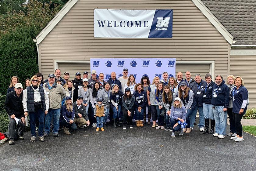Photo of MU Alums gathering at Alumni House on campus