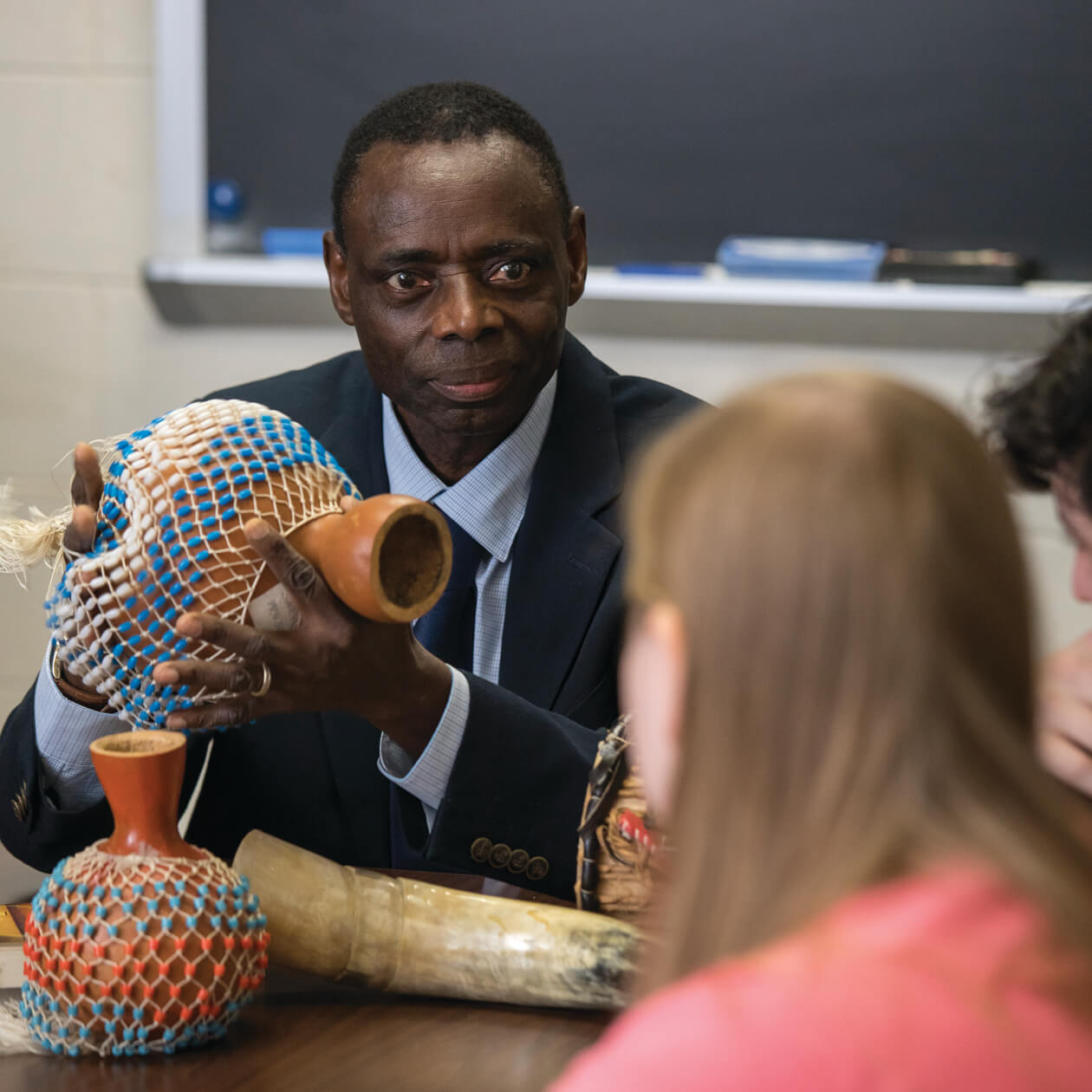 History professor with artifacts