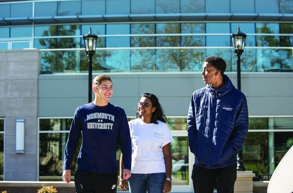 Three Monmouth students walking around campus
