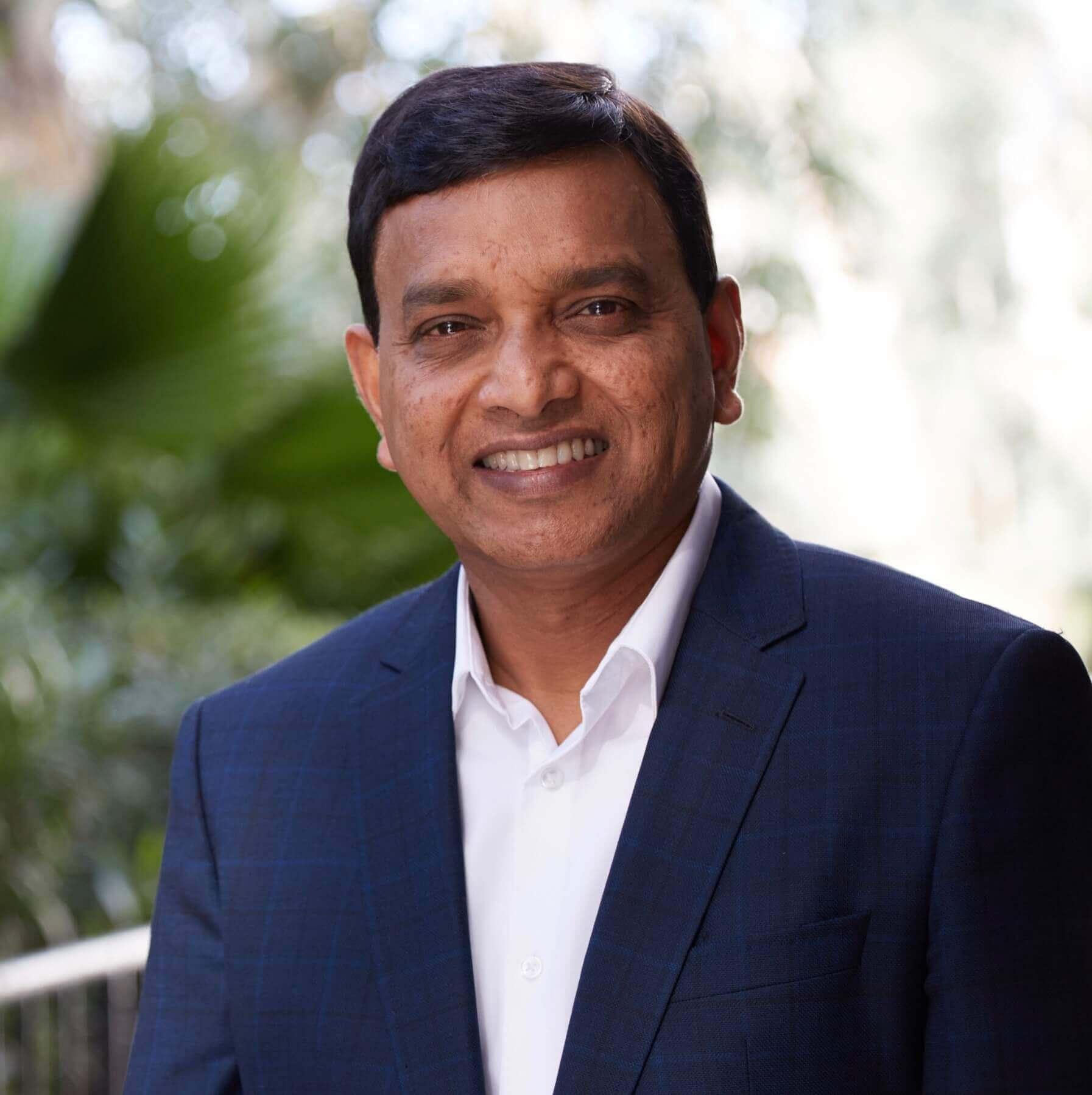Headshot of Krish Ramakrishnan