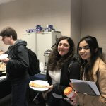 Photo shows more students in line for pie on Pi Day