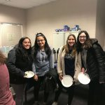 Photo shows students eagerly waiting in line for pie