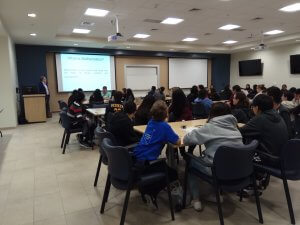 Photo shows Dr. Coyle welcomes students to Math Day