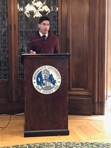 Photo shows student Rodriguez presenting at Honors School conference
