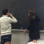 Student Nate Rodriguez and Dr. Susan Marshall tackle a math problem on the blackboard - Photo 1