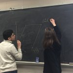Student Nate Rodriguez and Dr. Susan Marshall tackle a math problem on the blackboard - Photo 3