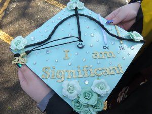 Photo shows mortarboard designed by student at commencment stating I Am Significant