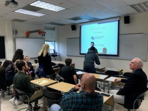 """Photo of Dr. Francis Valiquette, organizer of Math & Cookies, giving his presentation about """"Makimon's Visual Calculus."""""""