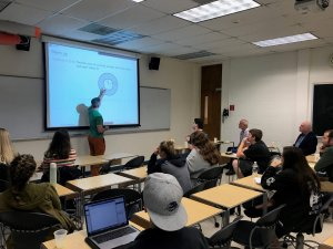 "Photo shows attentive group of math scholars, faculty and students learning about ""Makimon's Visual Calculus."""