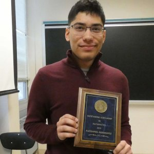 Photo of MU Senior Nathaniel Rodriguez with his Outstanding Scholarship in Mathematics award plaque