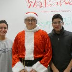 Photo of Coloring Contest winners with Dr. Coyle in Santa suit