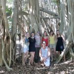 A group shot of students in front of trees