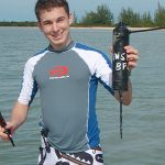 Student near water in the Bahamas