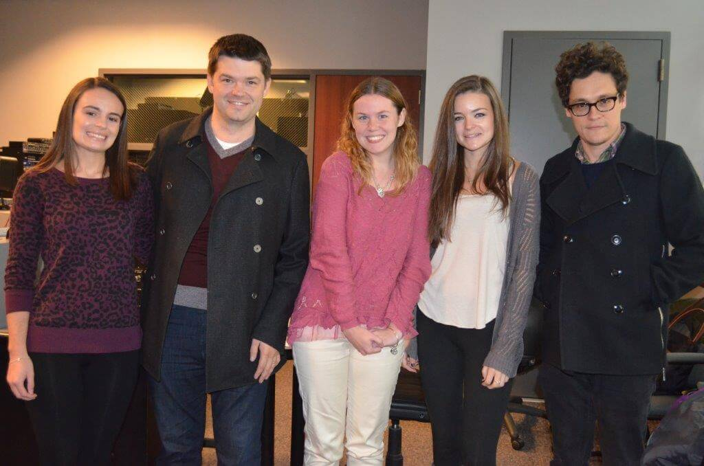 Photo of students with Students meeting with Phil Lord and Chris Miller before their MACE Award acceptance.