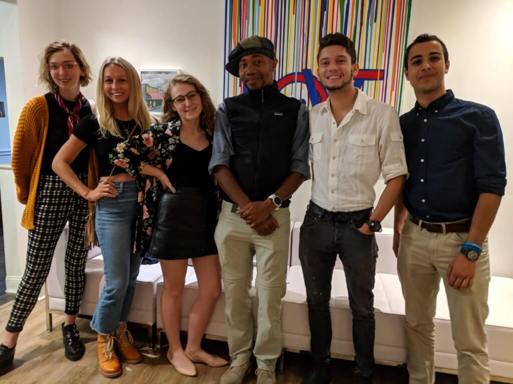 Photo of Communication students meeting with Paul D. Miller aka DJ Spooky after his campus concert.