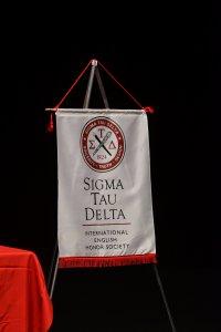 Photo shows Sigma Tau Delta banner