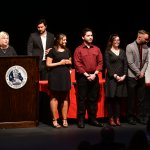 Photo shows student award recipients on stage