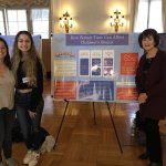 "Photo shows Oliva Monahan, Grace Remshifski and Prof. Linda Sacks at ""Service Learning Showcase"" event"
