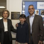 Photo of Mrs. Janine Evarts, son Geoff Evarts and grandson William outside of the Evarts Seminar Room.