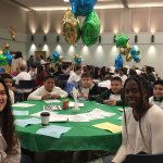 Photo shows EN-101-19 students celebrating the success of their project with Long Branch Public Schools.