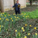 Photo shows Dean Michael Thomas read Wordsworth among the daffodils.