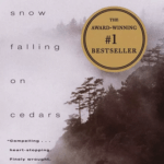 An image of the cover of Snow Falling on Cedars, the books title is on the left side of the image with a fogged in image of cedar tress on the right.