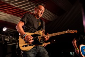 Photo of Bruce Springsteen on stage playing guitar.