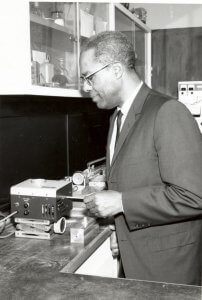 Photo of Dr. Walter S. McAfee conducting work in the lab in 1946.