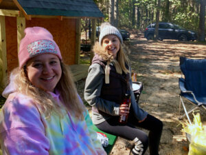 Photo of two Ecotherapy Students taking a break during their field trip