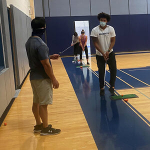 Photo shows students taking Golf 1 (PE 119)