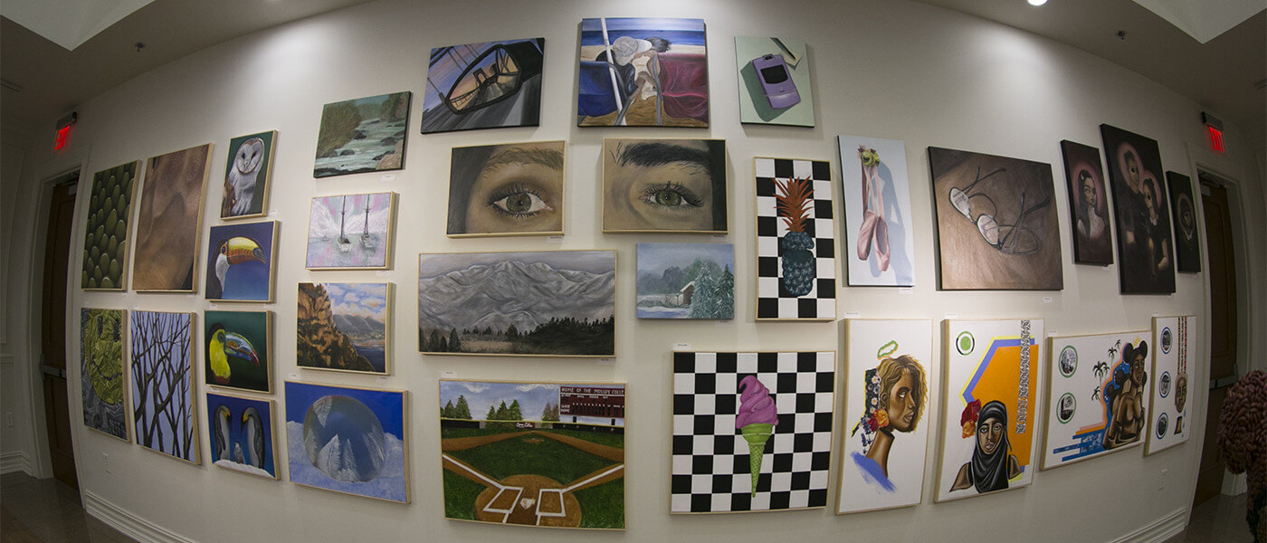 A fisheye lens shot of paintings hanging on a wall
