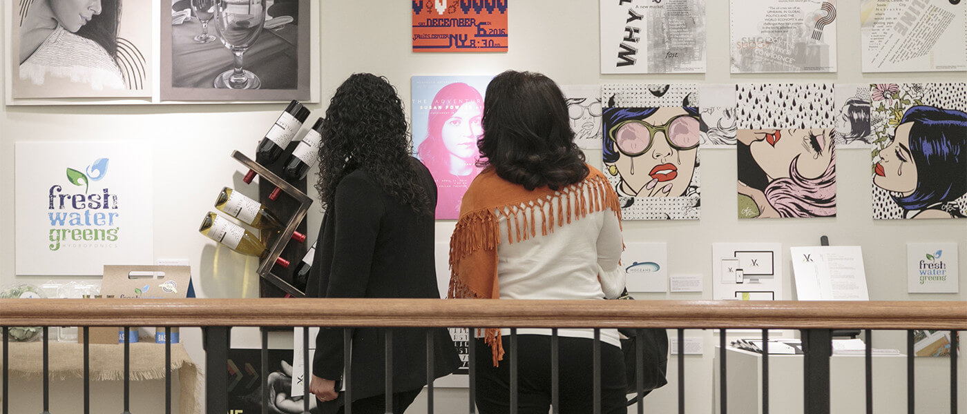 Gallery visitors observing student art