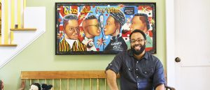 Kevin Young sitting in front of a painting