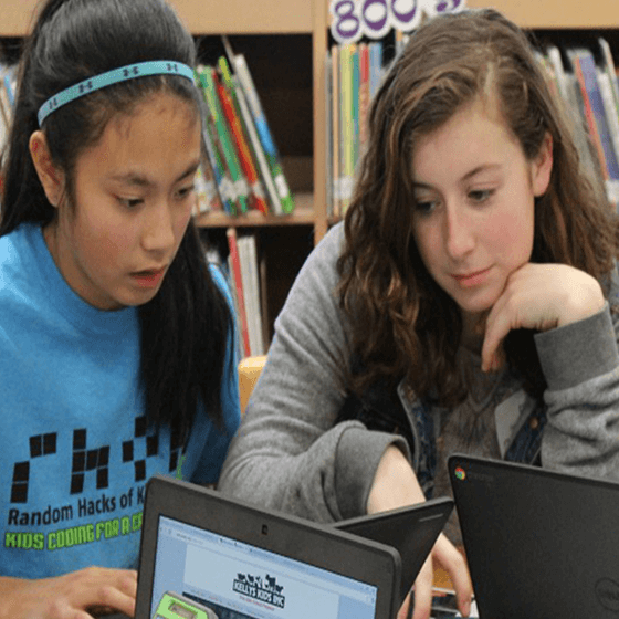 Photo of two female elementary school students studying