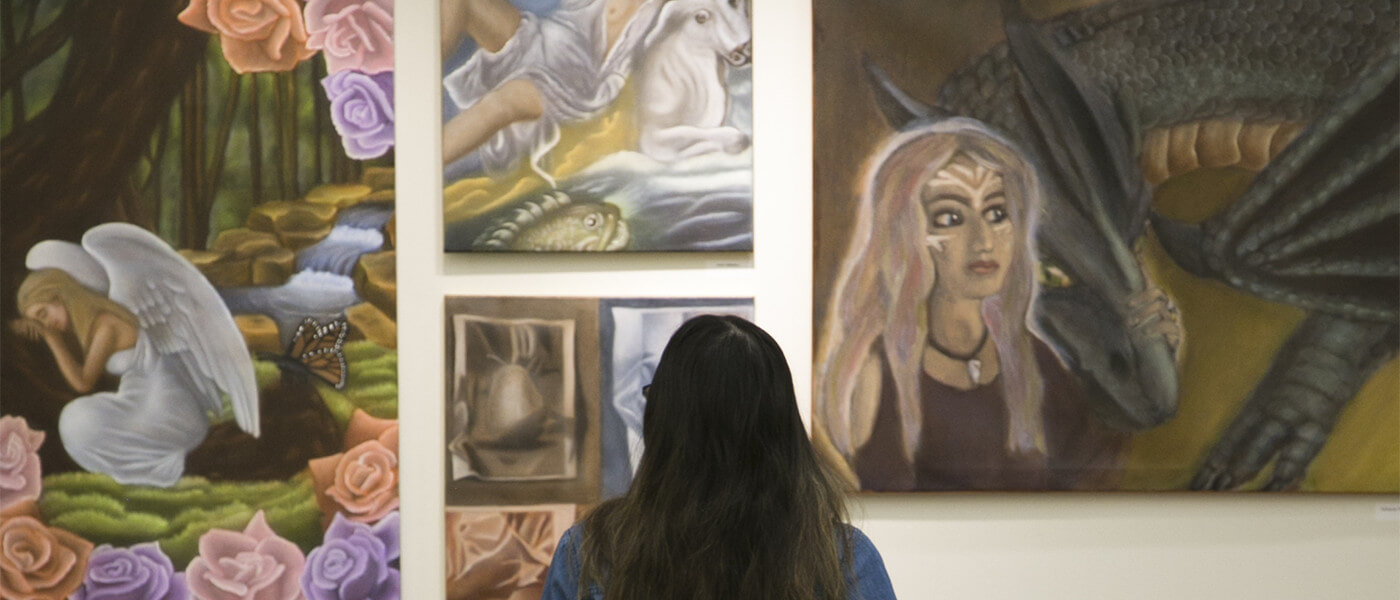 Gallery visitor observing student art