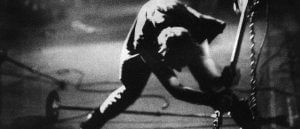 Photo of Paul Simonon smashing his guitar--the same photo later used as the album art for London Calling