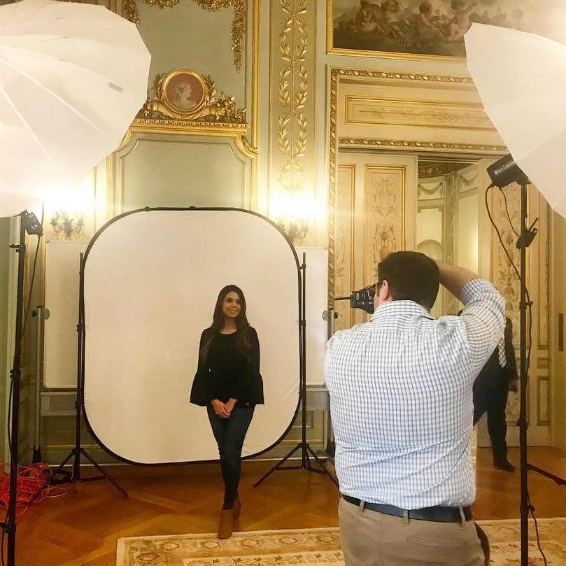 Photo of a student having her picture taken in Wilson Hall
