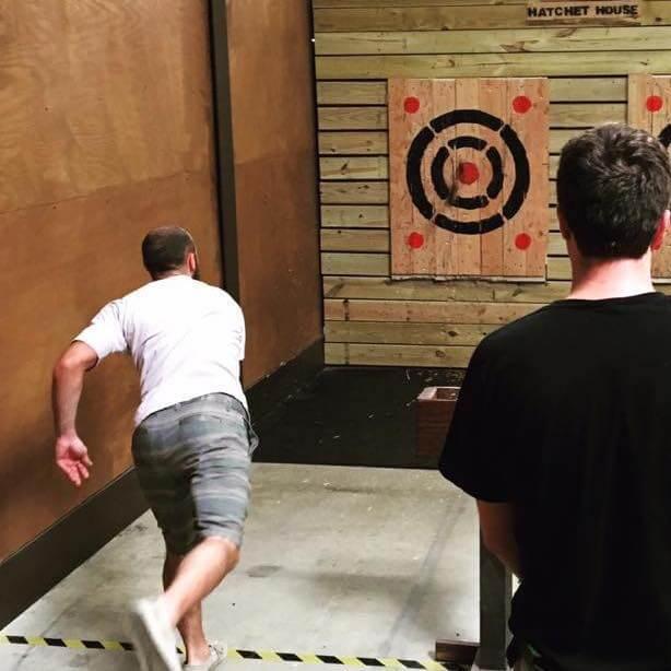 Man throwing hatchet at target in Stumpy's Hatchet House