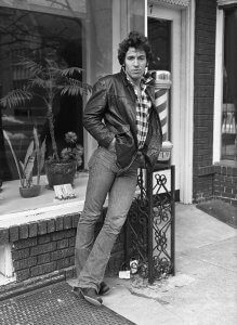 Bruce Springsteen leaning on a barbershop pole