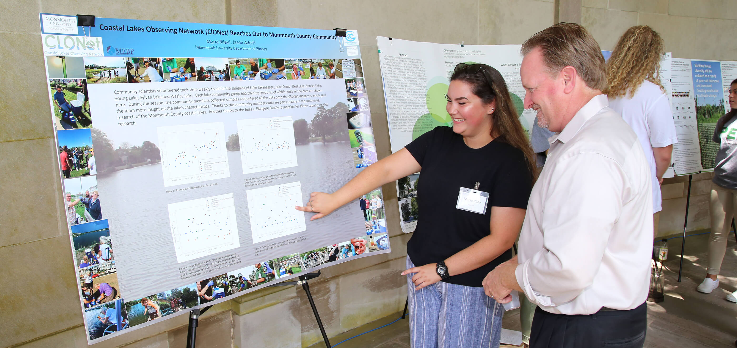 Student presenting research to professors at the Summer Research Program Symposium