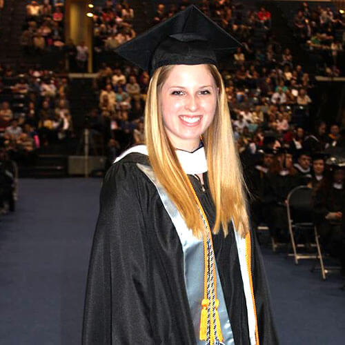 Colleen Thomas wearing a cap and gown during commencement