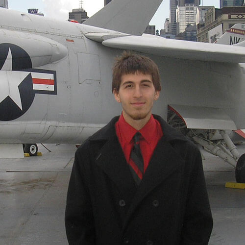 Kyle Durso in front of a fighter jet