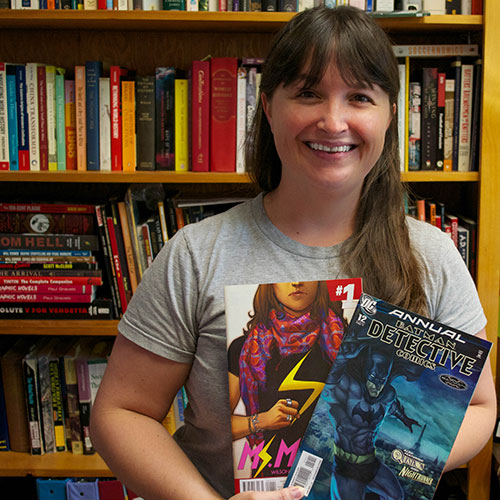 Maryanne Rhett holding two comic books