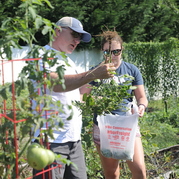 Photo shows volunteers working at the Virginia A. Cory Community Garden