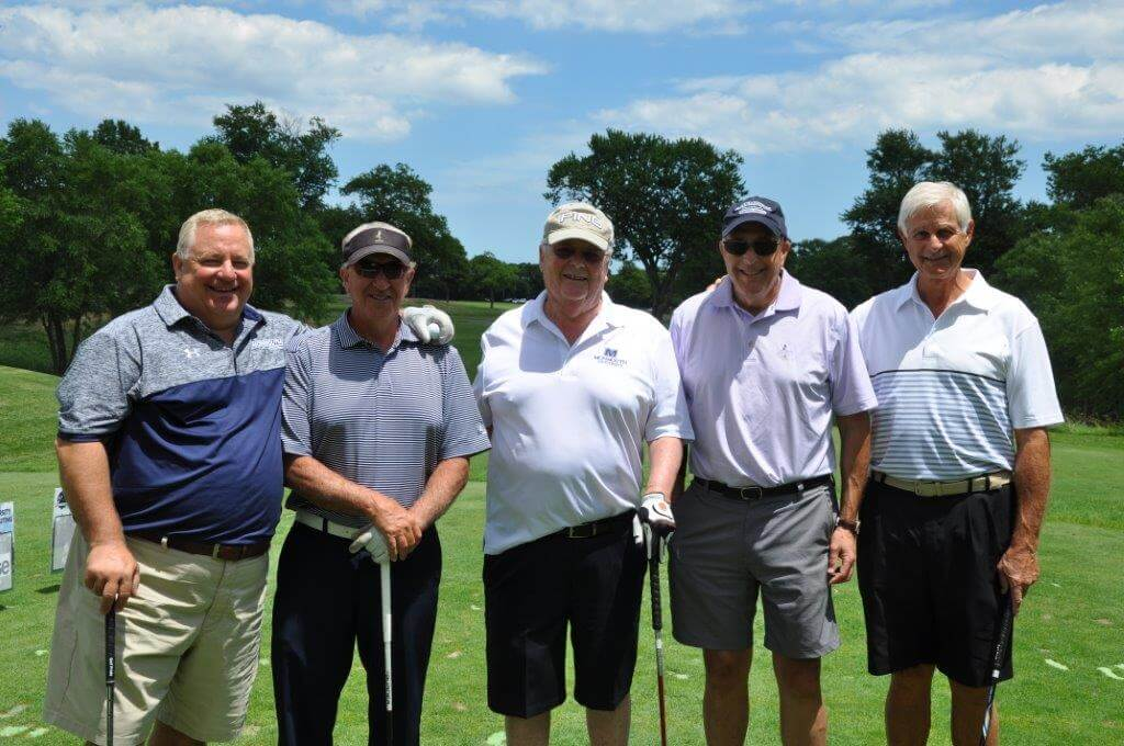 Attendees of the prior MU Golf Outings pose for a group shot at the Deal Golf And Country Club